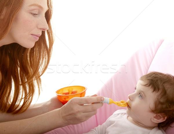 mother feeding baby yellow spoon Stock photo © lunamarina