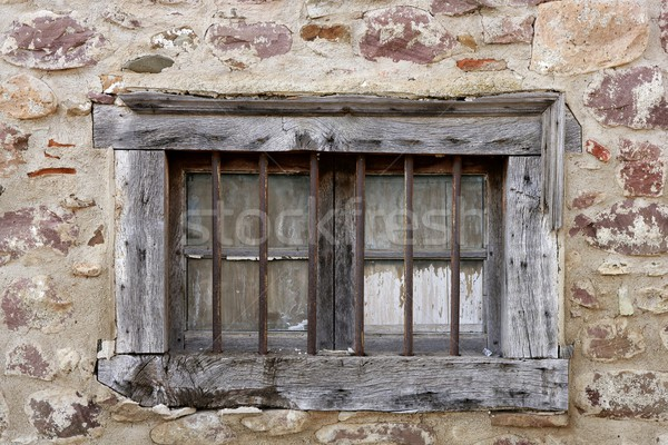 Aged wooden window in masonry stone house Stock photo © lunamarina