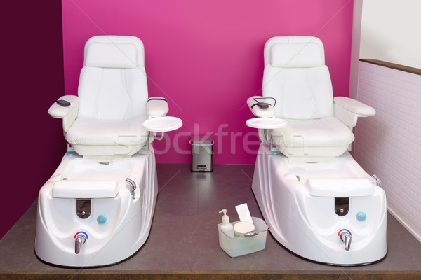 Nail saloon Pedicure chair spa furniture in pink wall Stock photo © lunamarina
