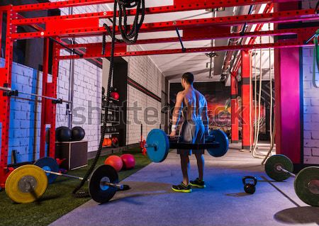battling ropes man at gym workout exercise Stock photo © lunamarina