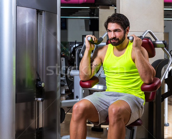 Abdominal crunch machine workout man Stock photo © lunamarina