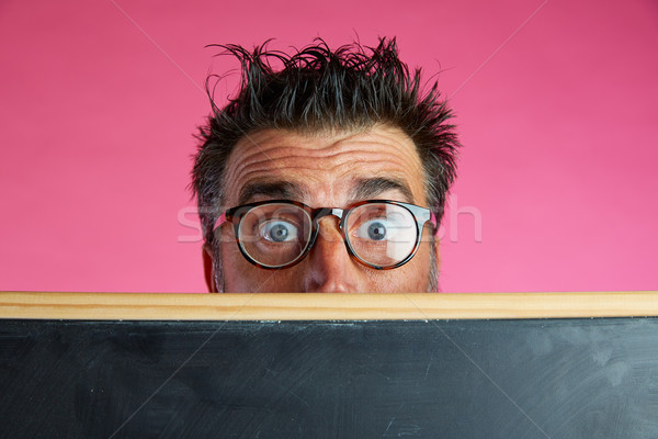 Nerd man crazy behind blackboard funny gesture Stock photo © lunamarina