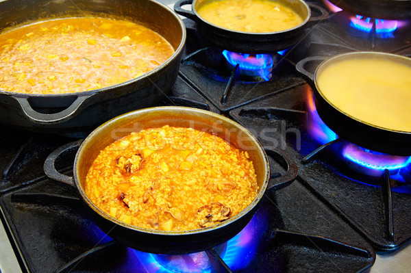 Seafood paella cooking process with squid Stock photo © lunamarina