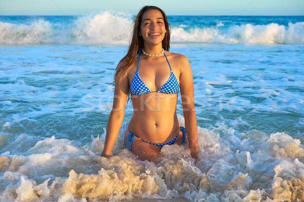Latin bikini girl happy sitting in Caribbean Stock photo © lunamarina