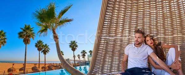 Pareja playa sombrilla playa tropical turísticos vacaciones de verano Foto stock © lunamarina