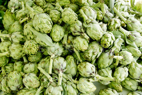 artichokes vegetables in a market mound Stock photo © lunamarina