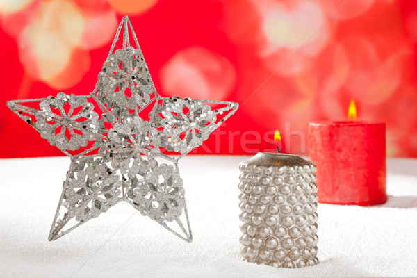 Christmas card of silver star and candle on snow Stock photo © lunamarina