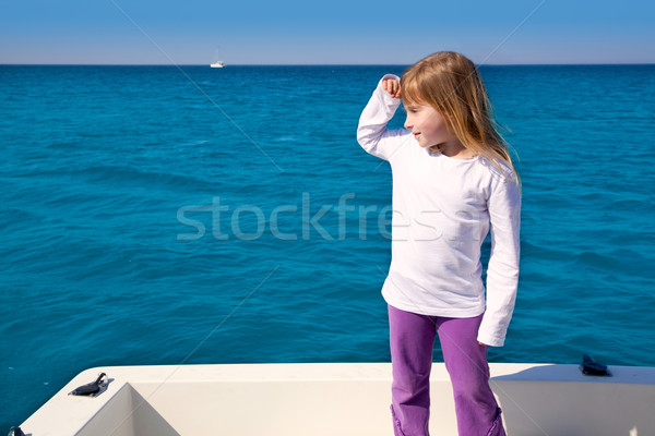 blond little kid girl sailing in a boat looking away Stock photo © lunamarina