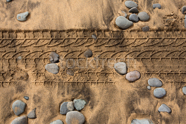 car tire footpring in a sand stones beach Stock photo © lunamarina