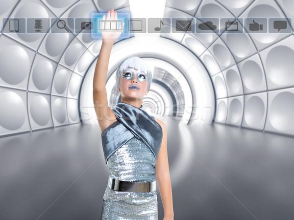 futuristic kid girl in silver touching finger icons Stock photo © lunamarina