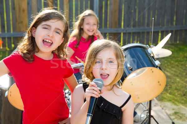 chidren singer girl singing playing live band in backyard Stock photo © lunamarina