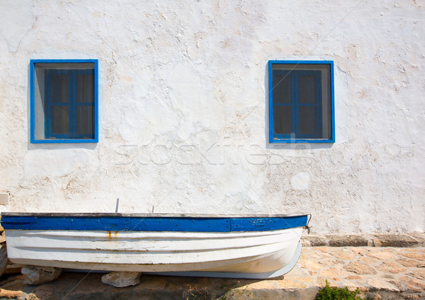 Mediterranean boat and whitewashed wall in white and blue Stock photo © lunamarina
