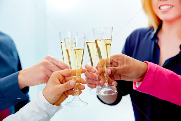 Happy business team toasting with champagne Stock photo © lunamarina