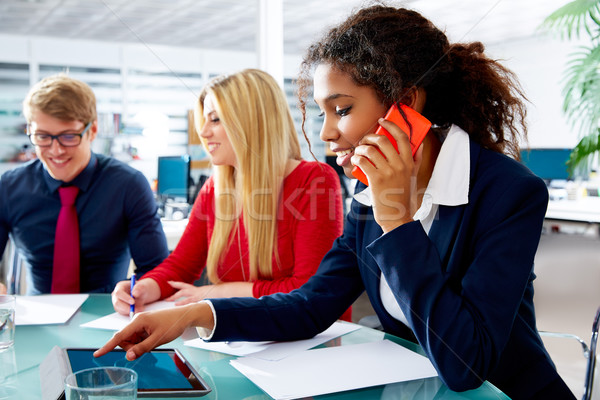 African businesswoman talking phone touch pad Stock photo © lunamarina