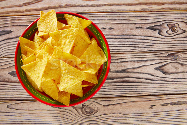 Nachos mexican food tortilla on red white wood Stock photo © lunamarina