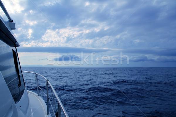 Csónak vitorlázik felhős viharos nap kék Stock fotó © lunamarina