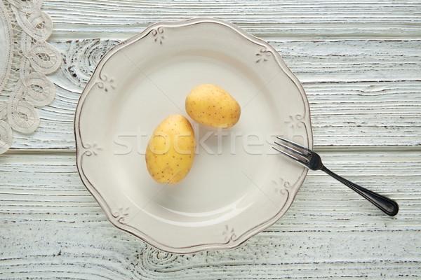potatoes in white plate minimalist food concept Stock photo © lunamarina