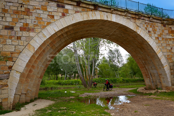 Zamora bridge and bike pilgrim of Via de la Plata Stock photo © lunamarina
