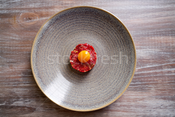 Steak Tartare raw meat recipe with egg yolk Stock photo © lunamarina