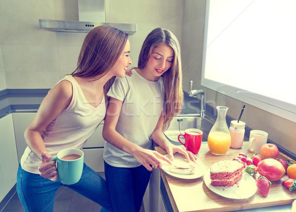 best friends girls teens breakfast in kitchen Stock photo © lunamarina