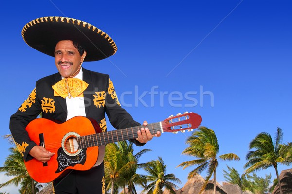 Charro mexican Mariachi playing guitar in beach Stock photo © lunamarina
