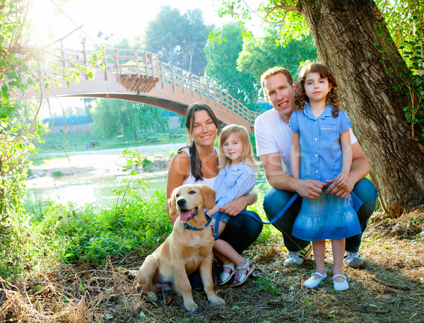 Family father mother kids and dog outdoor Stock photo © lunamarina