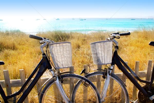bicycles couple parked in Formentera beach Stock photo © lunamarina