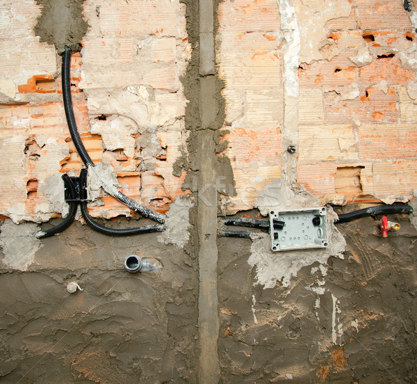 electrical and plumbing installation in kitchen work Stock photo © lunamarina