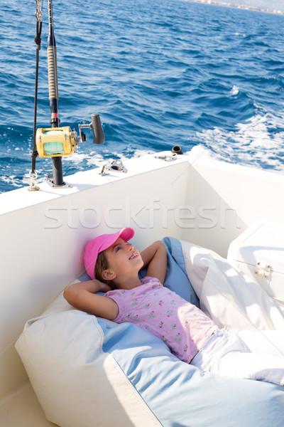 Dziecko dziewczyna żeglarstwo łodzi pokład Zdjęcia stock © lunamarina