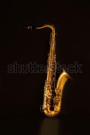 Sax golden tenor saxophone in black Stock photo © lunamarina