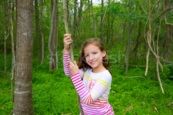Happy girl playing in forest park jungle with liana Stock photo © lunamarina