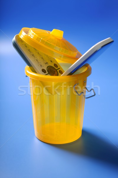 Mobil cell phone on the trash Stock photo © lunamarina