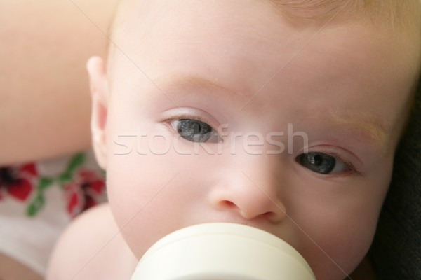 Baby blond little girl feeding drinking milk Stock photo © lunamarina