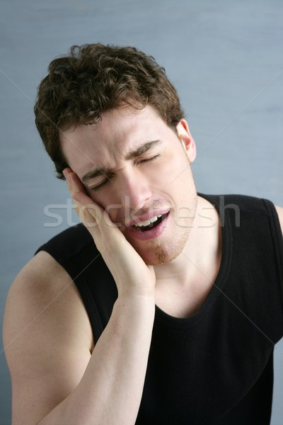 toothache headache pain gesture young man Stock photo © lunamarina
