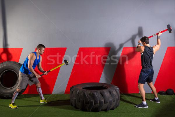 Sledgehammer Tire Hits men workout at gym Stock photo © lunamarina