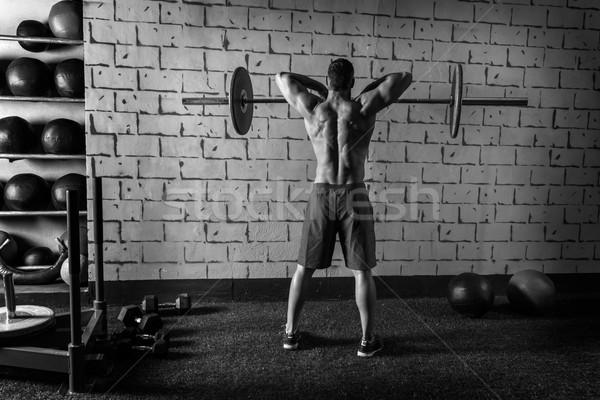 Barra con pesas levantamiento de pesas hombre entrenamiento gimnasio Foto stock © lunamarina