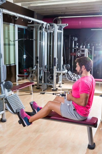seated cable row man rows at gym pulley machine Stock photo © lunamarina