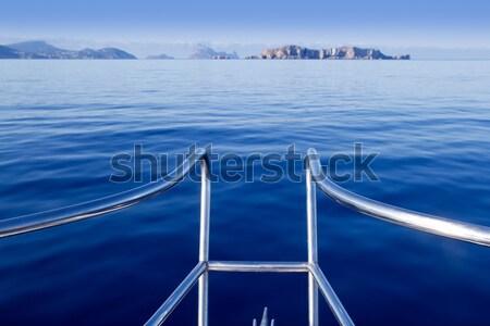 boat sailing blue calm ocean sea bow railing Stock photo © lunamarina
