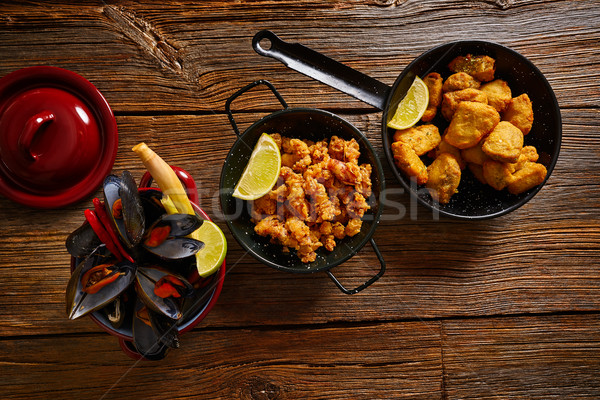 Fish seafood tapas adobo squid and mussels Stock photo © lunamarina