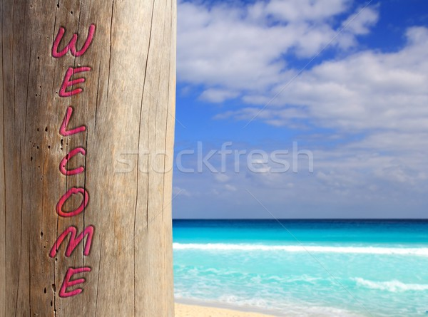 Caribbean beach spell welcome written in pole Stock photo © lunamarina