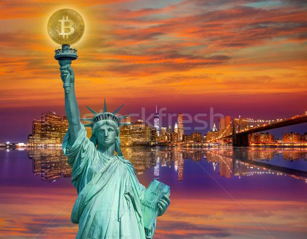New york skyline with liberty holding bitcoin Stock photo © lunamarina