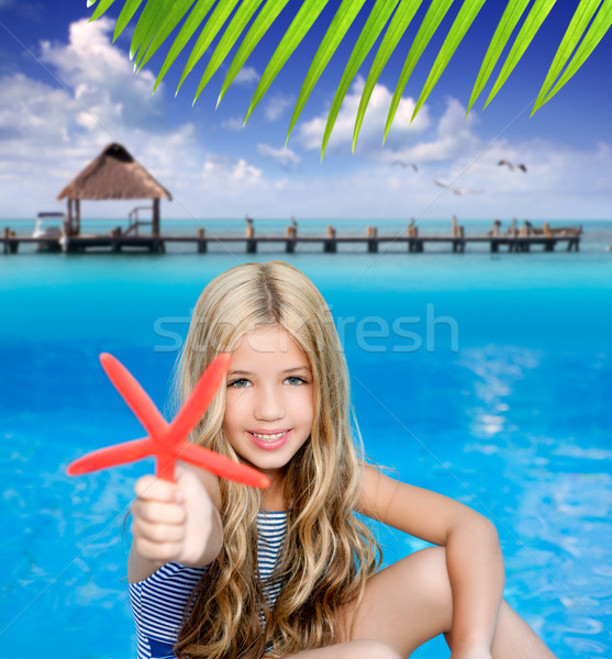 Crianças loiro menina férias de verão praia tropical starfish Foto stock © lunamarina