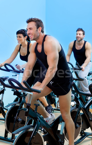 Mozdulatlan biciklik fitnessz férfi tornaterem sport Stock fotó © lunamarina