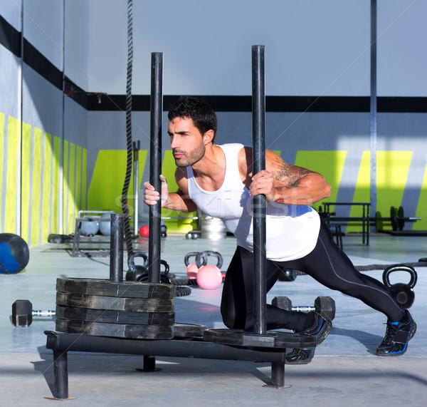 Crossfit lökés férfi toló súlyok edzés Stock fotó © lunamarina