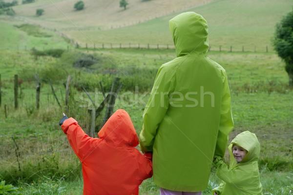Zielone łące wodoodporny kolorowy płaszcz plastikowe Zdjęcia stock © lunamarina