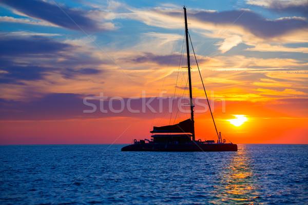 Ibiza san Antonio Abad catamaran sailboat sunset Stock photo © lunamarina