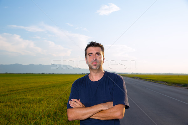 Stock photo: Mid age man in road at meadows posing crossed arms