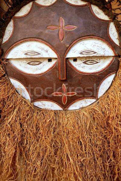 Africano étnico guerreiro escudo cara Foto stock © lunamarina