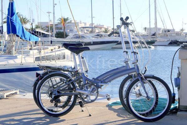 two bicycles marine folding bike on marina Stock photo © lunamarina