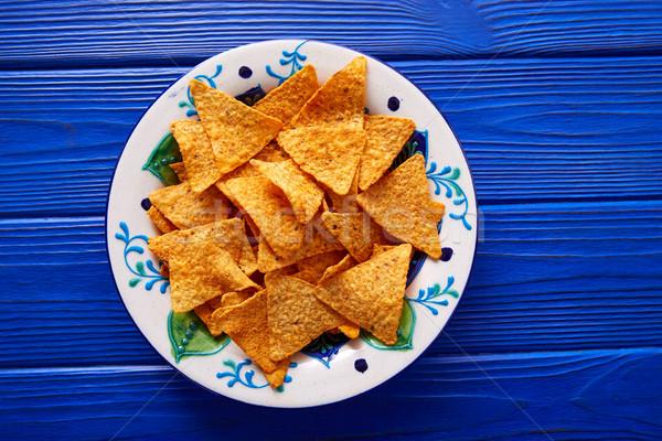 Nachos batatas fritas mexicano prato azul mesa de madeira Foto stock © lunamarina